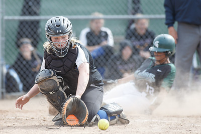 Maloney's Mackenzie Washington beats the throw home to add to the Spartans lead Thursday at Dunn Sports Complex in Meriden May 10, 2018 | Justin Weekes / Special to the Record-Journal