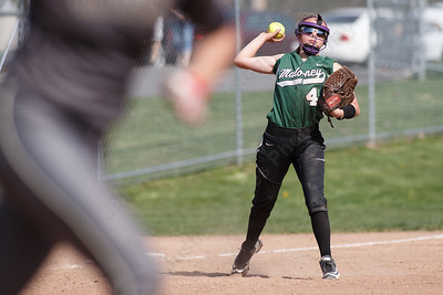 Maloney's Skyler Drost tries to throw out Platt's Caitlyn Hart at first Wednesday at Platt High School in Meriden May 2, 2018 | Justin Weekes / Special to the Record-Journal