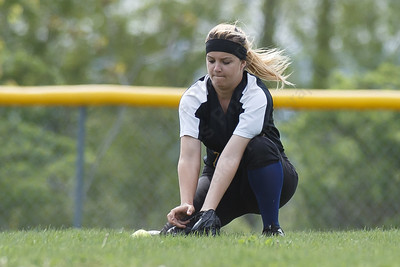 Wilcox Tech's Alexandra Nissle fields a hit Thursday at Dunn Sports Complex in Meriden May 10, 2018 | Justin Weekes / Special to the Record-Journal