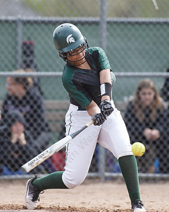 Maloney's Mackenzie Washington drives a hit to left field Thursday at Dunn Sports Complex in Meriden May 10, 2018 | Justin Weekes / Special to the Record-Journal