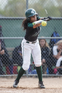 Maloney's Milytza Perez gets a bunt to drop in play Thursday at Dunn Sports Complex in Meriden May 10, 2018 | Justin Weekes / Special to the Record-Journal
