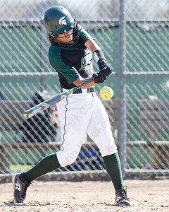 Maloney's Milytza Perez drives a shot to right center Monday at Dunn Sports Complex in Meriden April 23, 2018 | Justin Weekes / Special to the Record-Journal