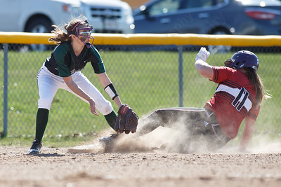 Manchester's Gabriella Giannantoni beats the throw to Maloney's Skyler Drost Monday at Dunn Sports Complex in Meriden April 23, 2018 | Justin Weekes / Special to the Record-Journal