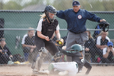 Maloney's Haley Kennedy beats the throw home Thursday at Dunn Sports Complex in Meriden May 10, 2018 | Justin Weekes / Special to the Record-Journal
