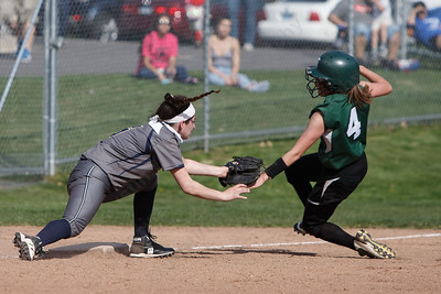 Platt's Alexandria Gill gets Maloney's Skyler Drost at third Wednesday at Platt High School in Meriden May 2, 2018 | Justin Weekes / Special to the Record-Journal