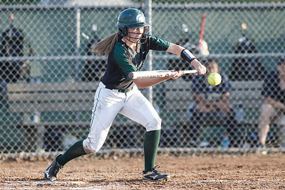 Maloney's Anna Hendrickson gets on board with a bunt Monday at Dunn Sports Complex in Meriden  May 21, 2018 | Justin Weekes / Special to the Record-Journal