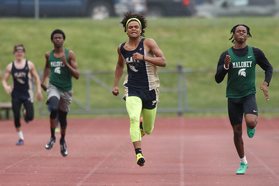 Platt's Elijah Felton takes the 400 over Maloney's Dhamani Johnson right Wednesday at Platt High School in Meriden May 16, 2018 | Justin Weekes / Special to the Record-Journal
