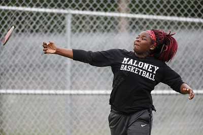 Maloney's Britney Diakpieng in the discus Wednesday at Platt High School in Meriden May 16, 2018 | Justin Weekes / Special to the Record-Journal