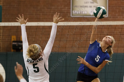 Southington's Caroline Barry (5) sends one down the line beating Maloney's Megan Guest (5) Wednesday at Maloney High School in Meriden September,24 2014 | Justin Weekes / For the Record-Journal