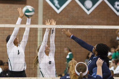 Maloney's Gabby Graham (8) and Katherine Longworth (6) block Middletown's Cianna Outlaw (17) Monday at Maloney High School in Meriden  September,15 2014 | Justin Weekes / For the Record-Journal