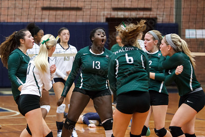 Maloney celebrates after winning a point Monday at Platt High School in Meriden September,29 2014 | Justin Weekes / For the Record-Journal