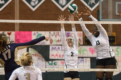 Maloney's Adriana Ward and Riley Maloney get up to block Platt's Gabriela Vazquez Wednesday at Maloney High School in Meriden  October,22 2014 | Justin Weekes / For the Record-Journal