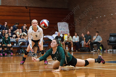 Maloney's Kasey Jimenez (12) dive for a short serve Monday at Platt High School in Meriden September,29 2014 | Justin Weekes / For the Record-Journal