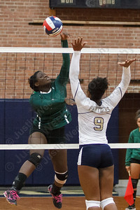 Maloney's Adriana Ward (13) cuts one past Platt's Destiny West (9) Monday at Platt High School in Meriden September,29 2014 | Justin Weekes / For the Record-Journal