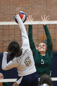 Maloney's Meghan Guest (5) reaches to block Platt's Daelyn Marrow (6) Monday at Platt High School in Meriden September,29 2014 | Justin Weekes / For the Record-Journal