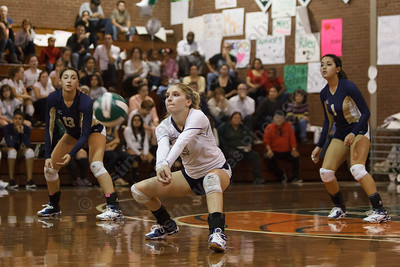 Maloney's Haley Ruzchak digs a Platt serve Wednesday at Maloney High School in Meriden  October,22 2014 | Justin Weekes / For the Record-Journal