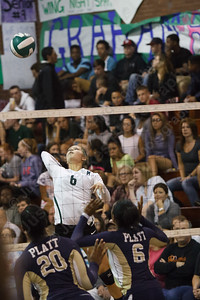 Maloney's Katherine Longworth line up a spike attempt as Platt's Daelyn Marrow and Nakajai Mills get ready to block Wednesday at Maloney High School in Meriden  October,22 2014 | Justin Weekes / For the Record-Journal