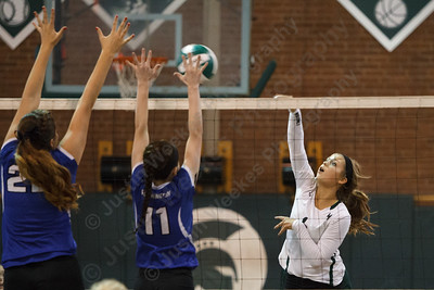 Maloney's Catherine Longworth (6) lines up a kill as Southington's Morgan McCarthy (11) and Sylwia Lewkowicz (22)  try to block Wednesday at Maloney High School in Meriden September,24 2014 | Justin Weekes / For the Record-Journal