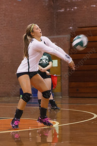 Maloney's Katherine Longworth digs a serve from Middletown Monday at Maloney High School in Meriden  September,15 2014 | Justin Weekes / For the Record-Journal