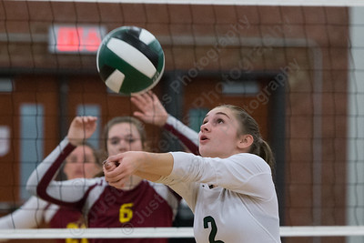 Maloney's Carly Massicotte digs a pass Wednesday at Maloney High School in Meriden October 11, 2017 | Justin Weekes / For the Record-Journal