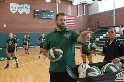 Maloney's head coach Kevin Savejs directs warm up Wednesday during a scrimmage with Hale Ray at Maloney High School in Meriden Aug. 30, 2017 | Justin Weekes / For the Record-Journal