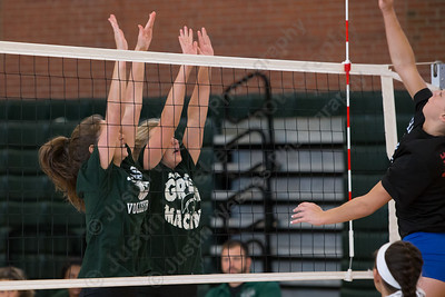Maloney's Grace Anatrella  and Anna Hendrickson jump to block  Wednesday during a scrimmage with Hale Ray at Maloney High School in Meriden Aug. 30, 2017 | Justin Weekes / For the Record-Journal
