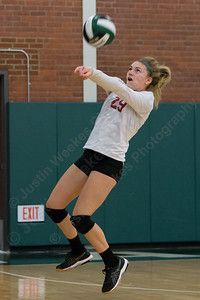 Sheehan's Emily Musso plays a dig over the net Wednesday at Maloney High School in Meriden October 11, 2017 | Justin Weekes / For the Record-Journal
