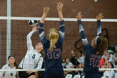 Maloney's Anna Hendrickson gets a spike over Avon blockers Wednesday at Maloney High School in Meriden September 13, 2017 | Justin Weekes / For the Record-Journal