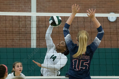 Maloney's Shanice Smith sends a spike over Avon's Emily Dempsey Wednesday at Maloney High School in Meriden September 13, 2017 | Justin Weekes / For the Record-Journal