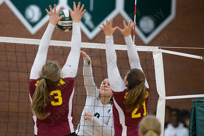Maloney's Melanie Polanco plays a spike through Sheehan's blockers Wednesday at Maloney High School in Meriden October 11, 2017 | Justin Weekes / For the Record-Journal