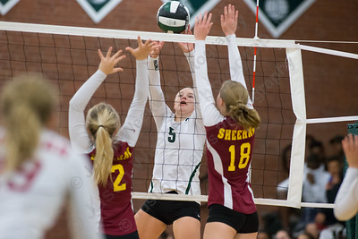 Maloney's Anna Hendrickson plays a touch over Sheehan's blockers Wednesday at Maloney High School in Meriden October 11, 2017 | Justin Weekes / For the Record-Journal