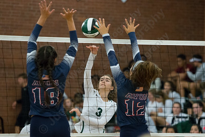 Maloney's Grace Anetrella gets a spike over Avon's defenders Wednesday at Maloney High School in Meriden September 13, 2017 | Justin Weekes / For the Record-Journal