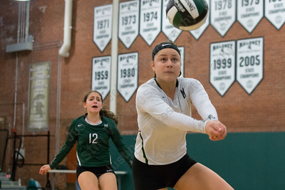 Maloney's Melanie Polanco plays a dig back in play Wednesday at Maloney High School in Meriden October 11, 2017 | Justin Weekes / For the Record-Journal