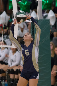 Platt's Caitlyn Hart plays a touch over the net Monday at Maloney High School in Meriden October 2, 2017 | Justin Weekes / For the Record-Journal