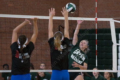 Maloney's Anna Hendrickson gets a touch ovet Hale Ray's defenders Wednesday during a scrimmage with Hale Ray at Maloney High School in Meriden Aug. 30, 2017 | Justin Weekes / For the Record-Journal