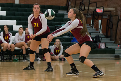 Sheehan's Samantha Iannone digs a Maloney serve Wednesday at Maloney High School in Meriden October 11, 2017 | Justin Weekes / For the Record-Journal