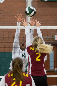 Maloney's Shanice Smith jumps to block Sheehan's Macey Sundwall Wednesday at Maloney High School in Meriden October 11, 2017 | Justin Weekes / For the Record-Journal