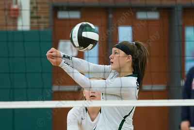 Maloney's Melanie Polanco digs a touch over the net Wednesday at Maloney High School in Meriden September 13, 2017 | Justin Weekes / For the Record-Journal