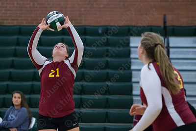 Sheehan's Carolyn Biel sets for Caitlyn Hunt Wednesday at Maloney High School in Meriden October 11, 2017 | Justin Weekes / For the Record-Journal