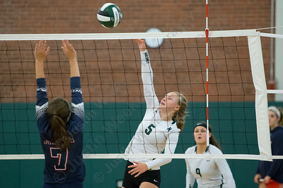 Maloney's Anna Hendrickson cuts a spike past Avon's Audrey Worth Wednesday at Maloney High School in Meriden September 13, 2017 | Justin Weekes / For the Record-Journal