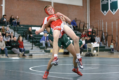 Maloney's Jayden Robles takes down Berlin's Nathan Orde Wednesday at Maloney High School in Meriden January 10, 2018 | Justin Weekes / Special to the Record-Journal
