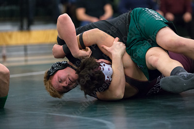 Maloney's Nikolas DeBaise pins Bristol Central's Jakob Salinas Wednesday at Maloney High School in Meriden January 24, 2018 | Justin Weekes / Special to the Record-Journal