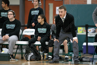 Maloney's head coach Eric Bergeron cheers on Tanner Raymond Wednesday at Maloney High School in Meriden January 10, 2018 | Justin Weekes / Special to the Record-Journal