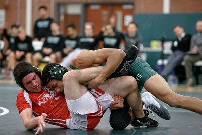 Maloney's Markeese Thompson rolls Berlin's Joshua Veleas Wednesday at Maloney High School in Meriden January 10, 2018 | Justin Weekes / Special to the Record-Journal