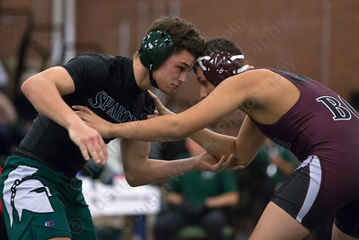 Maloney's Tanner Raymond locks up with Bristol Central's Andrew Mahaffy Wednesday at Maloney High School in Meriden January 24, 2018 | Justin Weekes / Special to the Record-Journal