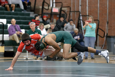 Maloney's Markeese Thompson takes down Berlin's Joshua Veleas Wednesday at Maloney High School in Meriden January 10, 2018 | Justin Weekes / Special to the Record-Journal