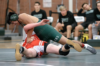 Maloney's Nikolas DeBaise tries to turn Berlin's Aidan O'Connor in the 182 class Wednesday at Maloney High School in Meriden January 10, 2018 | Justin Weekes / Special to the Record-Journal