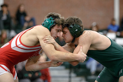 Maloney's Tanner Raymond locks up with Berlin's Moses Marino in the 152 class Wednesday at Maloney High School in Meriden January 10, 2018 | Justin Weekes / Special to the Record-Journal