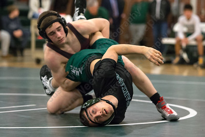 Maloney's Anthony LaFogg tries to escape Bristol Central's Mason Hale Wednesday at Maloney High School in Meriden January 24, 2018 | Justin Weekes / Special to the Record-Journal