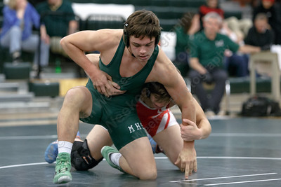 Maloney's Tanner Raymond escapes Berlin's Moses Marino in the 152 class Wednesday at Maloney High School in Meriden January 10, 2018 | Justin Weekes / Special to the Record-Journal